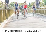 happy friends running bicycles... | Shutterstock . vector #721216579