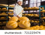 baker. a young handsome bakery... | Shutterstock . vector #721225474