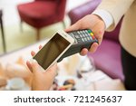 female paying with smart phone  ... | Shutterstock . vector #721245637