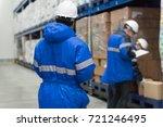 checking goods in freezing room ... | Shutterstock . vector #721246495