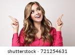 woman surprise showing  in... | Shutterstock . vector #721254631