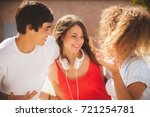 group of teenagers on the street | Shutterstock . vector #721254781