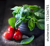basil and tomatoes on wooden... | Shutterstock . vector #721266751