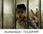 scary zombie in prison | Shutterstock . vector #721269499