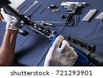 gunsmith cleaning gun rifle and ... | Shutterstock . vector #721293901