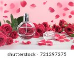 rose perfume bottle surrounded... | Shutterstock . vector #721297375