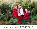 family selecting christmas tree.... | Shutterstock . vector #721302415