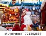 happy little girl in warm... | Shutterstock . vector #721302889