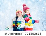 kids playing in snow. children... | Shutterstock . vector #721303615