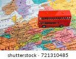 red bus on the map of europe | Shutterstock . vector #721310485