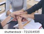 groups of putting hands...   Shutterstock . vector #721314535