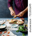 man cooking italian bruschetta... | Shutterstock . vector #721331695