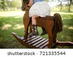 Toddler A Rocking Horse Outdoors - Fine Art prints