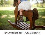 Toddler A Rocking Horse Outdoors - Fine Art prints