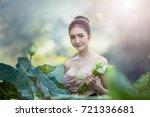 asian woman harvest lotus... | Shutterstock . vector #721336681