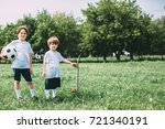 two sports boys with a soccer... | Shutterstock . vector #721340191