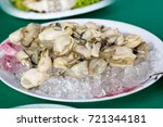 oyster on green table  best... | Shutterstock . vector #721344181