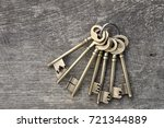 Old Keys In A Ring On Wooden...