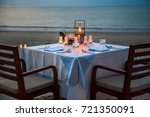 dinner table on the beach at... | Shutterstock . vector #721350091
