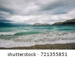 beautiful waves at the beach | Shutterstock . vector #721355851