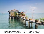 cottage by the sea and blue sky. | Shutterstock . vector #721359769