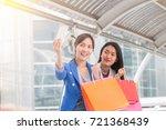 happy asia women looking at her ... | Shutterstock . vector #721368439