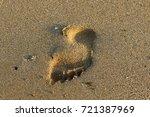footprints in the sand | Shutterstock . vector #721387969