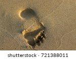 footprints in the sand | Shutterstock . vector #721388011