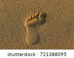 footprints in the sand | Shutterstock . vector #721388095