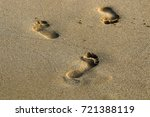 footprints in the sand | Shutterstock . vector #721388119