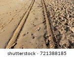 footprints in the sand | Shutterstock . vector #721388185