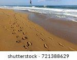 footprints in the sand | Shutterstock . vector #721388629