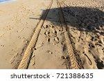 footprints in the sand | Shutterstock . vector #721388635