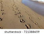 footprints in the sand | Shutterstock . vector #721388659