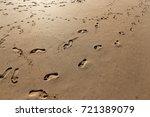 footprints in the sand | Shutterstock . vector #721389079