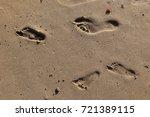 footprints in the sand | Shutterstock . vector #721389115