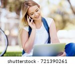 woman working outdoors in a... | Shutterstock . vector #721390261