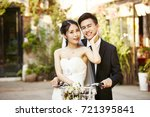 happy newly wed asian couple... | Shutterstock . vector #721395841