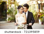 happy newly wed asian couple... | Shutterstock . vector #721395859