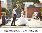 young asian bride and groom in... | Shutterstock . vector #721395955