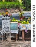 Small photo of Exotic fruits sold on the road, market stall, street hawker in French Polynesia, Moorea