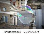 giant flying soap bubble in city   Shutterstock . vector #721409275
