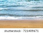 soft beautiful waves on sandy... | Shutterstock . vector #721409671