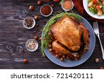 tasty roasted turkey on plate | Shutterstock . vector #721420111