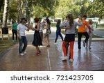 dancing in the gagarin park ...   Shutterstock . vector #721423705