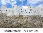 houses built over coast rocks... | Shutterstock . vector #721424221