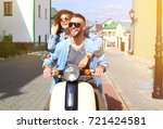 happy young couple riding... | Shutterstock . vector #721424581
