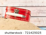 vintage red suitcase in sand at ... | Shutterstock . vector #721425025
