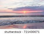 sunset on the beach. baltik sea  | Shutterstock . vector #721430071