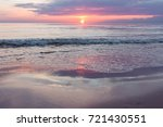 sunset on the beach. baltik sea  | Shutterstock . vector #721430551